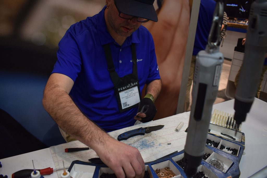 A man puts a Benchmade Knife together at SHOT Show